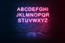 Neon Light Alphabet On  Iluminated Brick Wall.