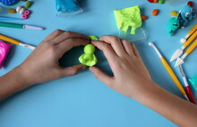 How To Make A Figurine From Plasticine Bunny Step By Step Step 4 Selective Focus. Children's Crafts. Handwork.