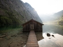 Panorama Reflection Of Old Wooden Boat House Shed Alpine Mountain Lake Obersee Koenigssee Berchtesgaden Bavaria Germany