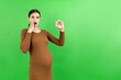 Leinwandbild Motiv pregnant woman holding a bottle of pills against her belly at colorful background with copy space. Taking medication during pregnancy concept