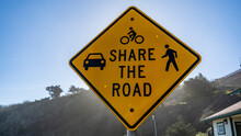 Share The Road Sign. Walking, Driving, Cycling