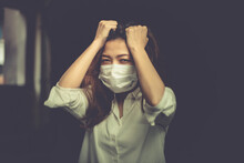 Portrait Of An Asian Woman Putting On A Sanitary Face And Locking Herself In The Room Because Of Being Ill From Being Infected With The Covid Virus 19 And Being Stressed