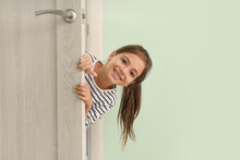 Cute Little Girl Looking Out The Door