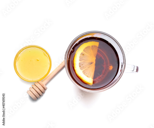 Glass cup of hot black tea with lemon and honey on white background Fototapeta