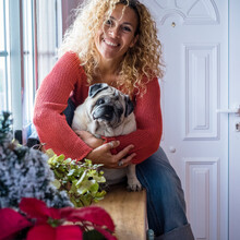 Cheerful Dog Owner Beautiful Adult Female At Home Hugging Her Pug With Love And Tenderly - Concept Of People And Animals Pet Therapy - Adorable Little Domestic Dog Lifestyle And Woman