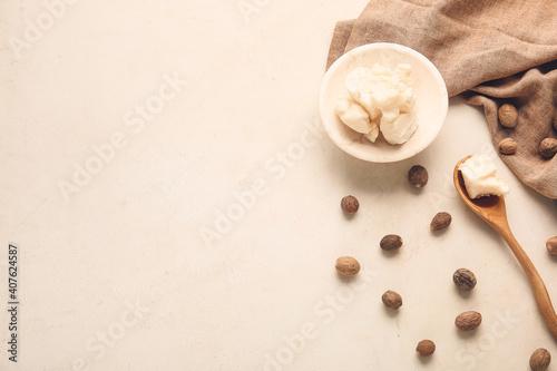 Obraz Shea butter with nuts on light background - fototapety do salonu