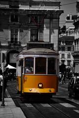 orange tram on the streets of Lisbon