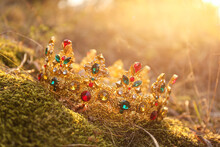 Beautiful Golden Crown On Grass Outdoors. Fantasy Item