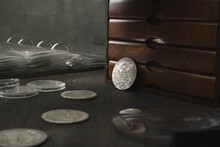 Numismatics. Old Collectible Coins Made Of Silver On A Wooden Table.