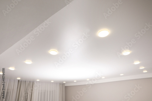 Canvas Print White stretch ceiling with spot lights in room