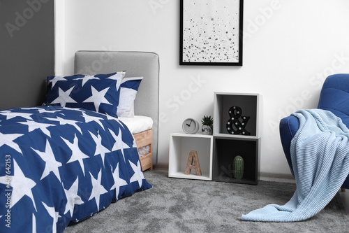 Fototapeta Bed with stylish linens in children's room