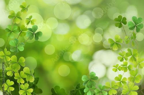 Fotografia, Obraz Fresh clover leaves on green background