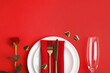 Leinwandbild Motiv Romantic table setting on red background, flat lay with space for text. Valentine's day celebration