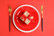Leinwandbild Motiv Elegant table setting for romantic dinner on red background, flat lay. Valentine's day celebration