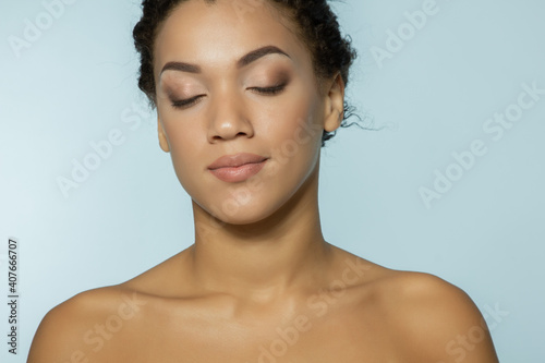 Young beautiful african american woman meditates or dreams Wallpaper Mural