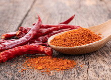 Chilli Powder  And  Dried Red Pepper On White Background