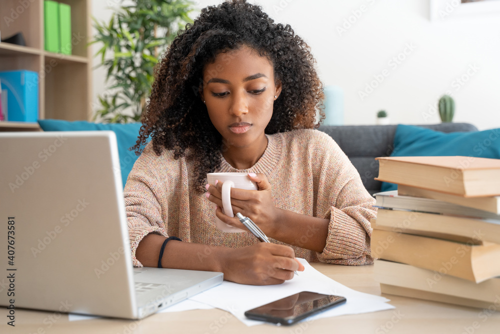 Fototapeta Home education. Black woman watching school lesson from home