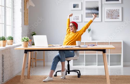 Happy female designer finishing work
