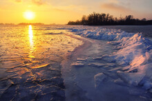 Sunrise And Frozen Sea. Beautiful Winter Landscape With Lake In Morning Time.