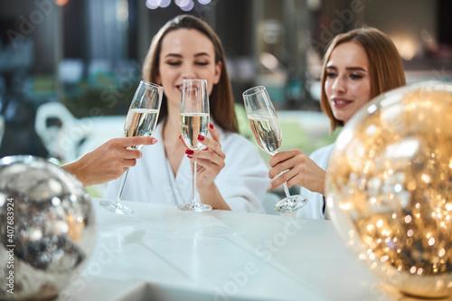 Beautiful women drinking champagne together and laughing © Viacheslav Iakobchuk