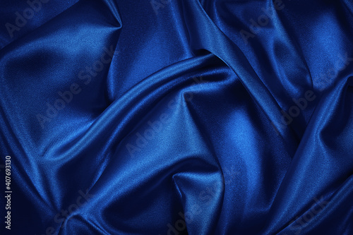 Photo Luxurious blue silk satin background