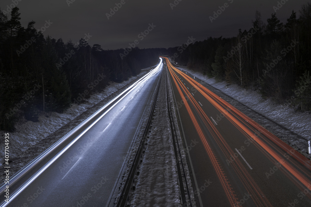 Fotografie, Obraz Long exposure of a road with light trails of passing vehicles