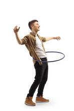 Full Length Shot Of A Happy Young Man Spinning A Hula Hoop