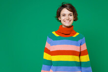 Smiling Cheerful Beautiful Attractive Young Brunette Woman 20s Years Old Wearing Basic Casual Colorful Sweater Standing And Looking Camera Isolated On Bright Green Color Background Studio Portrait.