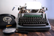 old typewriter on table, blank white sheet for text, mockup, retro style, concept of works of a writer, journalist