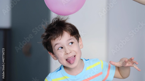 Fototapeta surprised cheerful boy with thorns in his hair without static electrification