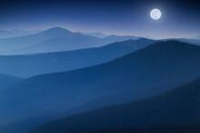 Bright Full  Moon Rises Over Hazy Colorado Rocky Mountain Range