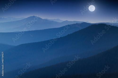 Carta da parati Bright Full  Moon Rises Over Hazy Colorado Rocky Mountain Range