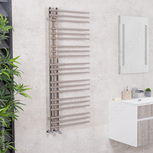 Fotomural Heated towel rail on a ceramic tiled wall in the bathroom