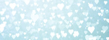 Valentines Day - Defocused White Hearts Background On Blue Background - February 14