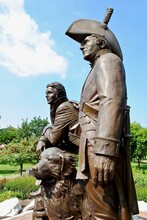 St. Charles, Missouri, USA: Lewis And Clark Statue In Frontier Park Near Missouri River. A Bronze Monument Features Meriwether Lewis And William Clark And Clark's Newfoundland Dog, Seaman.