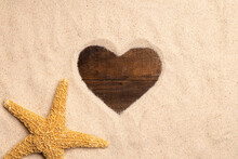 Love Concept Image Of Heart Shape Frame Made Of Sand On Wooden Background