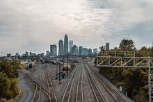 City Skyline And Train Rails