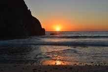 A Beautiful Blood Red Sunset Over The Pacific Ocean From Pfeiffer Beach In Big Sur, California.