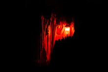 The Ghost Holds A Burning Lantern On A Dark Background. Horror.