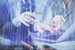 Multi exposure of man and woman working together and financial chart hologram. Business concept. Computer background.
