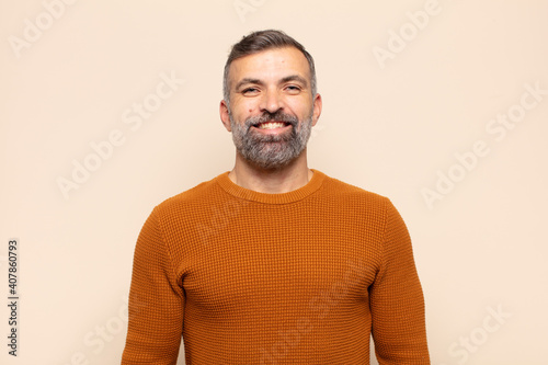 Fotografie, Obraz adult handsome man looking happy and goofy with a broad, fun, loony smile and ey