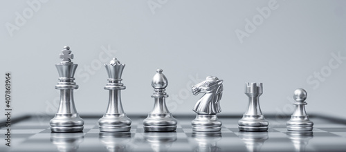 Canvas Print Silver Chess figure team (King, Queen, Bishop, Knight, Rook and Pawn) on Chessboard against opponent during battle