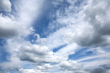 Beautiful Heaven Landscape With Dense Stormy White And Gray Clouds On Different Levels And Some Blue Sky Horizontal Photo