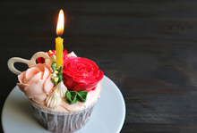 Decorative Birthday Cupcake Decorated With Rose Bouquet Shaped Frosting With A Shining Candle