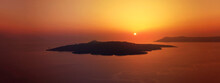 Panoramic Iconic Sunset With Golden Colours From Famous Village Of Imerovigli, Santorini Island, Cyclades, Greece