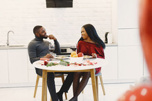 Valentines Day. Couple Sitting At Table, Having Meal, Talking And Laughing. Beautiful Couple Celebrating.