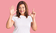Middle Age Latin Woman Wearing Casual White Tshirt Showing And Pointing Up With Fingers Number Seven While Smiling Confident And Happy.