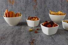 Mix Of Dry Vegetables And Fruits In White Bowls. Natural Homemade Snacks And Chips.