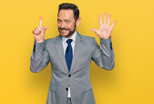 Middle Age Man Wearing Business Clothes Showing And Pointing Up With Fingers Number Seven While Smiling Confident And Happy.