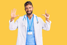 Young Hispanic Man Wearing Doctor Uniform And Stethoscope Showing And Pointing Up With Fingers Number Seven While Smiling Confident And Happy.